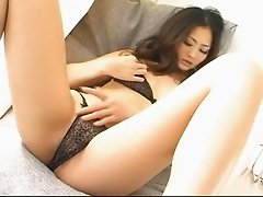Wholesome looking Risa pinches her perky nipples and fondles her pussy