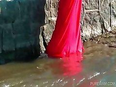 Brunette gets wet in the river