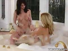 Emily Addison and Heather Vandeven in a hot foamy tub