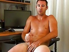 Hunk grabs cock and squeezes it