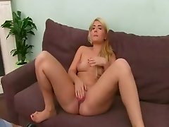 Big tits blonde teasing herself on sofa