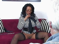 Brunette milf with huge muffins and glasses does striptease act