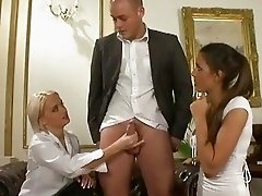 Two slutty MILF ladies giving dude a handjob