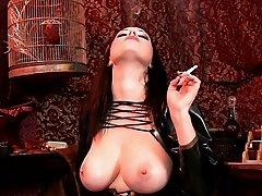 Smoking and showing big tits
