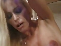 Pale blonde babe with big bosom giving blowjob