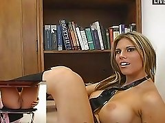 Hot blonde babe in black mini skirt masturbates