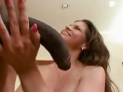 Cock starved babe June Summers blocks her lusty mouth with a monster boner