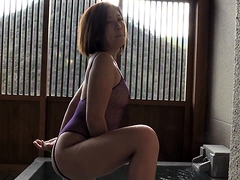 Sensual Japanese milf flaunts her curves and rubs her pussy
