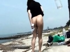Sizzling girl shot in the seaside by voyeur camera