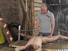 Restrained twink punished with hot candle wax and fucked