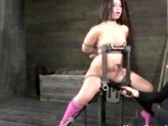 Brunette restrained in bondage chair