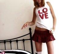 Hot teen in long socks poses naked in her bedroom