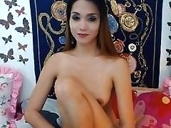 Cute transvestite with small tits masturbates for her webcam