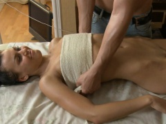 Beauty is playing with her slit during fleshly oil massage