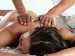 Naked Brunette Oiled Up On Massage Table