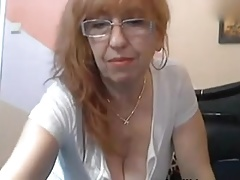 Naughty granny masturbates with dildo on cam