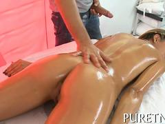 Oiled up Latina rubbed butt naked and fucked on massage table