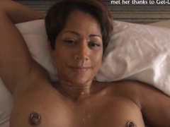 Busty MILF with short hair takes a facial