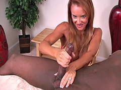 redhead milf with big tits and toned body gives a bbc a handjob