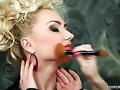 Blonde with piss on her face sucks a dick