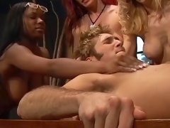 Busty babes takes turns fucking dude with huge strap on