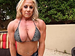 Ugly muscular chick toys her love tube outdoors