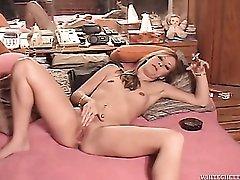 Slut talks dirty as she rubs her pussy