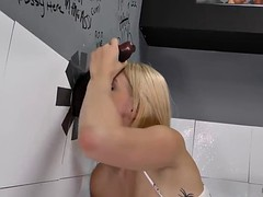 giselle palmer enjoys playing with a black cock from a glory hole