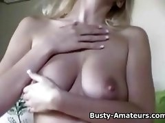 Busty Autumn masturbates in bed