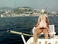 70s guy takes hot blonde out on yacht and enjoys blowjob and hardcore fuck