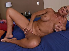 Short haired milf displays her tight aged body while masturbating