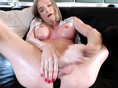 Slender blonde shemale with big round tits makes herself cum