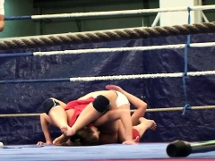 Muscular lesbians wrestling in a boxing ring