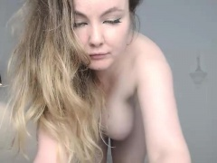 Sexy blonde with nice boobs fingering herself