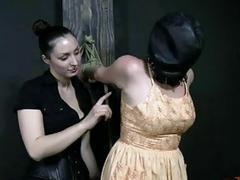 Lezdom mistress fucks around with her hooded slave BDSM porn