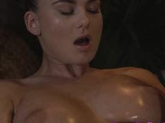 Busty masseuse fingering lesbian client