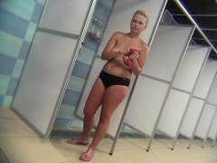 Sexy showering milfs ignorant of spy cam