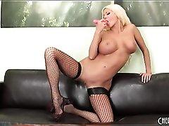 Sexy bimbo in fishnets masturbates