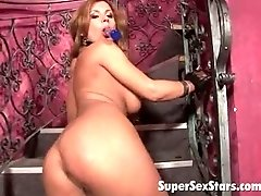 Enchanting pornstar dildoing her pierced beaver on the stairs