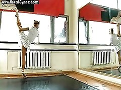 Masked ballerina dances on point and strips