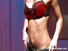 Busty chick stripping and dancing in front an audience