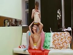 Two spanish chicks play with strong man