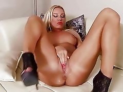 Beautiful Sandy masturbating and fisting her pussy