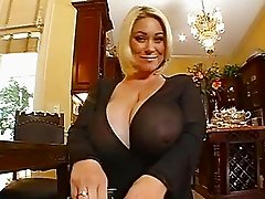 Heavy chested blonde momma doing a POV blowjob