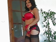 Heavy chested dark haired milf in lingerie plays with her hairy twat